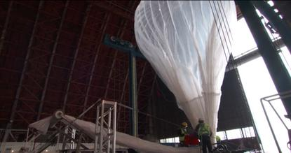 A Project Loon balloon shown under tests in a hangar in a Google promotional video