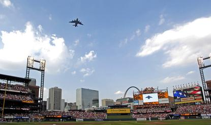 A C-17 Globemaster III flies over Busch Stadium in St. Louis before the Cardinals-Giants baseball game July 7, 2007. The flyover was part of Air Force Week St Louis.