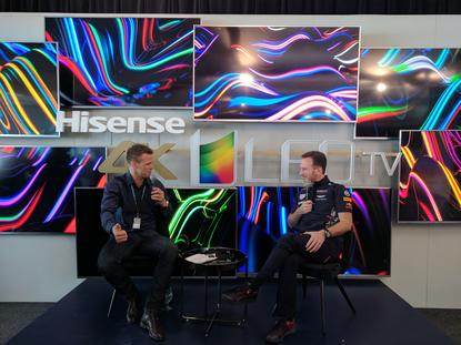 Former Gelong AFL star Lee Colber interviews Red Bull Racing Formula 1 boss, Christian Horner at the Melbourne 2017 Grand Prix while sitting in front of Hisense ULED TVs and launching the new Series 8 and Series 9 Hisense TVs.