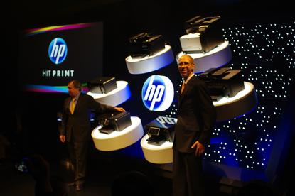 HP's Vyomesh Joshi and John Solomon unveil the new HP e-All-in-One cloud-based printer range.
