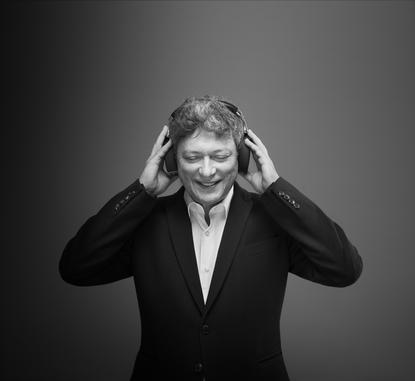 Pet sounds: Parrot CEO and founder, Henri Seydoux, wears the Zik headphones that came out of a collaboration with famed French designer, Philippe Starck