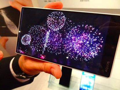 A Sharp smartphone plays slow-motion video with a high frame rate at a demonstration in Tokyo on May 25, 2015. Sharp says its latest Aquos phones with the feature have the highest rates for slow-motion video.