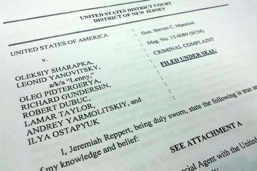 The cover page of a US federal complaint filed in New Jersey against eight people alleging wire fraud and money laundering.