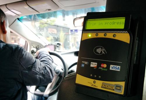 An NFC-enabled payment terminal in a San Francisco taxi that can accept both Apple Pay and Google Wallet