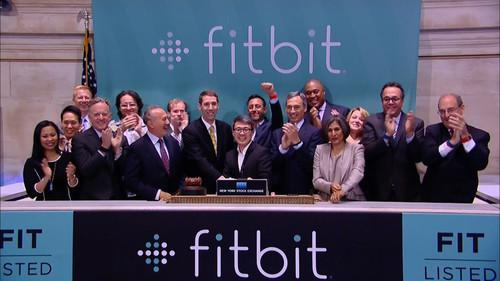 Executives of FitBit ring the opening bell and celebrate the start of trading of FitBit stock at the New York Stock Exchange on June 18, 2015.