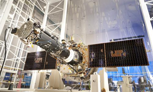 This is a photo of the complete IRIS observatory with the solar arrays deployed. This photo was taken in a large clean tent at LM prior to vibration testing and prior to installation of the flight MLI blankets. The front door, the aluminum disk to the far left end of the telescope tube, is now open and the observatory carrying out its solar observing mission.