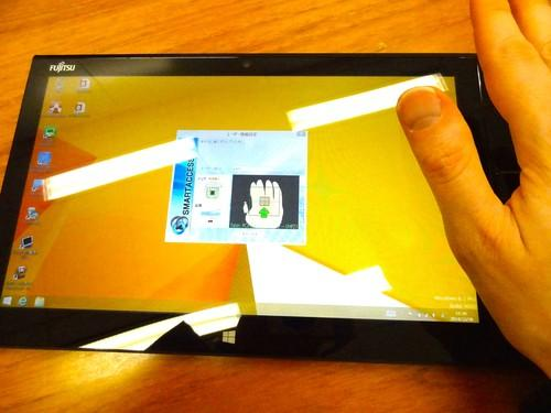 Fujitsu demonstrates a prototype 12.5-inch tablet with a stamp-sized palm-vein authentication scanner to verify user identity. Fujitsu hopes to embed the scanner in smartphones in the future.
