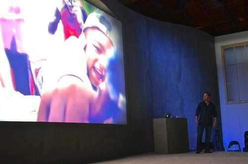 Dropbox CEO Drew Houston, admiring photos that can now be stored and shared with the company's new Carousel app.