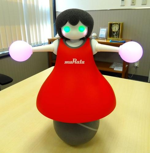 Murata Manufacturing's cheerleading robot balances on a ball and can do synchronized dance routines.