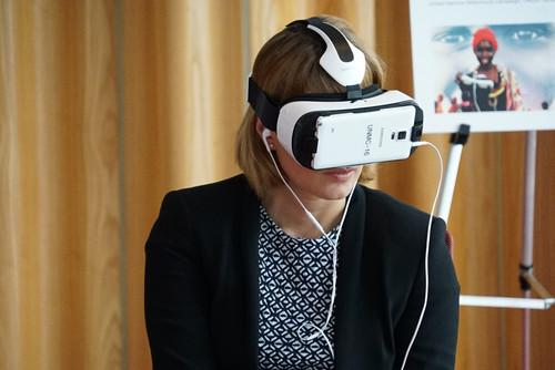 A Samsung Gear VR headset providing a virtual tour of a refugee camp