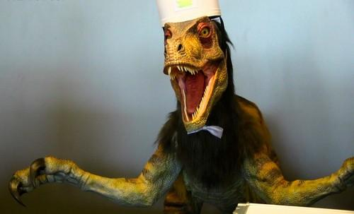 A robotic dinosaur clerk greets visitors to the Henn-na Hotel north of Nagasaki July 15, 2015. The budget hotel at the Dutch-themed Huis Ten Bosch amusement park is mainly staffed by robots.