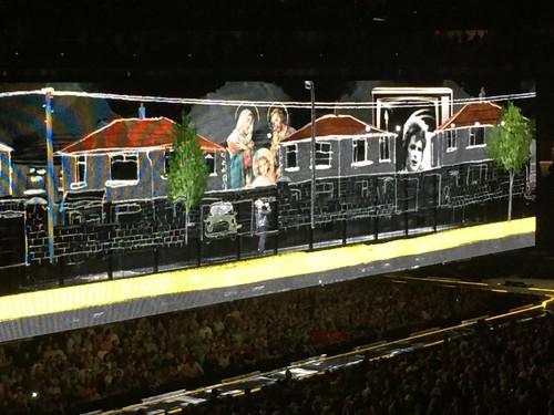 U2 singer Bono walks inside transparent LED video screens during a concert in Boston on July 14, 2015.