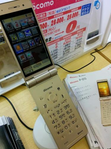 NTT DoCoMo's P-01G flip phone is seen at an electronics store in Tokyo. Feature phone shipments rose last year while smartphone shipments fell, according to one research group.