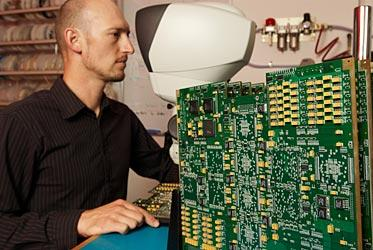 Matt Shields, a member of the CABB team, doing a quality check on a completed CABB signal processing board. (Image credit: Tim Morison, Patrick Jones Photographic Studio)