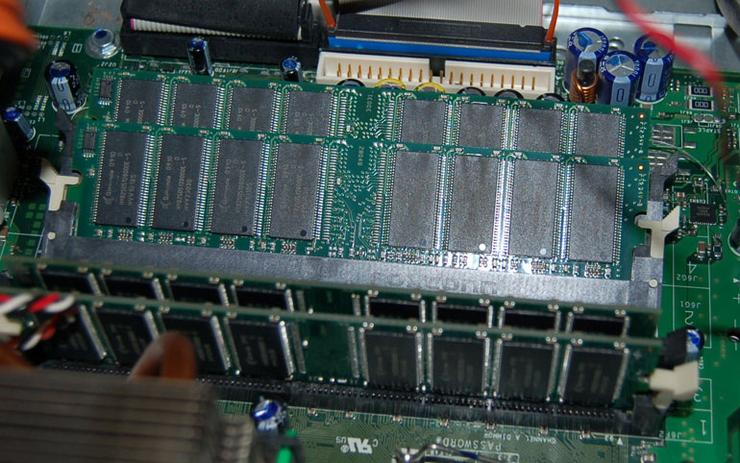 Next, add more RAM. Shown here: lining up the RAM cards in preparation for sliding them into the carrier one at a time.