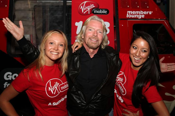 "Sir Richard Branson hosted Virgin Mobile's first ""surprise gig,"" held at Melbourne's Ding Dong lounge."