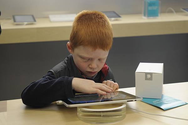 An enthusiastic young fan gets his first taste of the iPad in Australia.