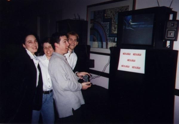 The GT Interactive team going hands-on with the original Metal Gear Solid on PlayStation at E3 1997 in Los Angeles.