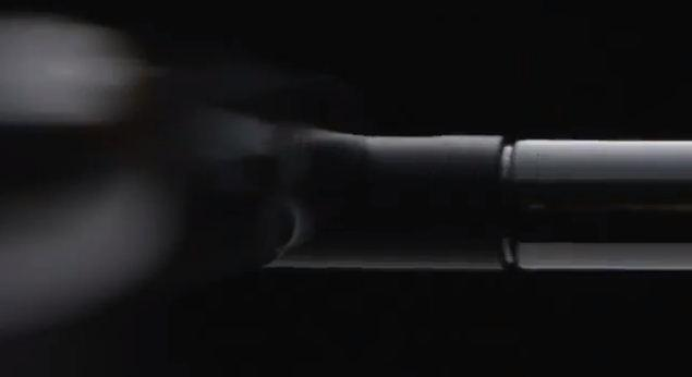 A screenshot of Samsung's teaser trailer posted on YouTube, showing a stylus being removed.