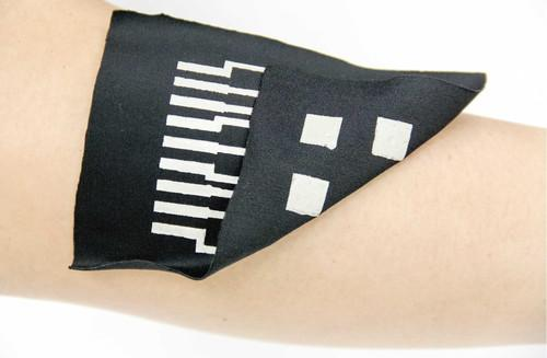 Japanese researchers said June 25, 2015, that they have made a prototype wrist band muscle activity sensor using functional ink that can maintain high conductivity while being stretched. The band has a muscle activity sensor that was produced by printing on each side of the flexible material's surface.