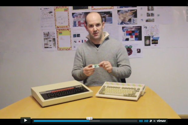 Eben Upton, creator of the Raspberry Pi, holds the 65x30mm Raspberry Pi Zero next to two of the home computers from his childhood in this screenshot from a video released by the Raspberry Pi Foundation on Nov. 26, 2015.  Credit: Screenshot by Peter Sayer