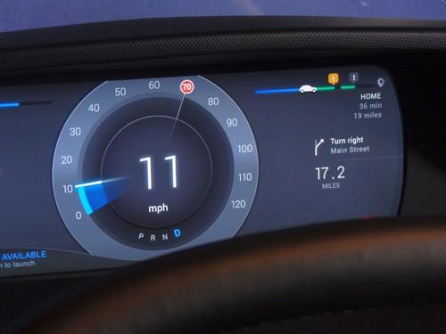 There may be trouble ahead, but Valeo wants jams to be a source of joy for drivers. In this prototype dashboard display for semi-autonomous vehicles, a summary of the journey appears in the top-right corner. Blue indicates the portion already completed, the exclamation marks in yellow and black bubbles indicate hazards, while stretches with traffic jams are shown not in the usual red but a cheery green. This, the company says, is because the first self-driving cars will be able to take over in slow-moving traffic jams, freeing drivers to do other things, such as listening to music or playing Real Racing 4 on their phone.