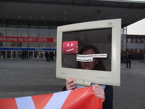 "A protestor disguised as a computer at the entrance to Cebit 2015 displays an error message: ""In China, freedom of speech is not available."""