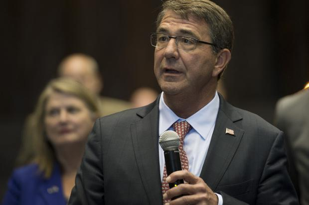 Secretary of Defense Ash Carter speaks with members of the media after delivering remarks at the National Full Scale Aerodynamics Complex in Moffett Field, Calif., Aug. 28, 2015. Credit: Adrian Cadiz/DOD