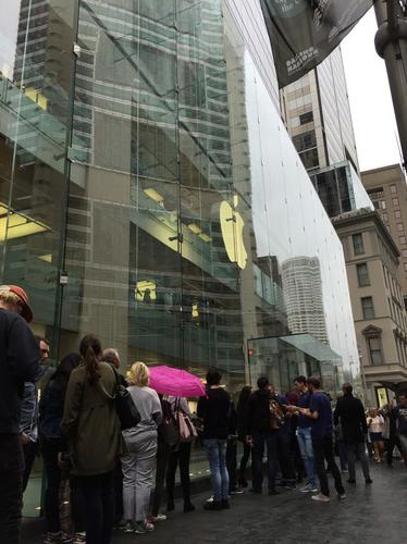 About two dozen people lined up outside Apple's downtown Sydney store on Friday, many of whom were interested in getting a preview of the company's Watch, which will be available in stores April 24.