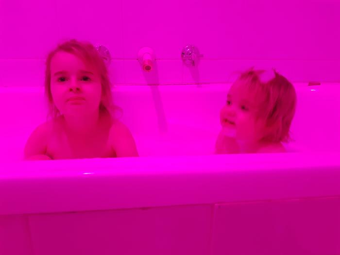 Pink Bubbles! Bathtime becomes more fun but then you have to stand there and keep changing the lights because the app won't do it automatically.