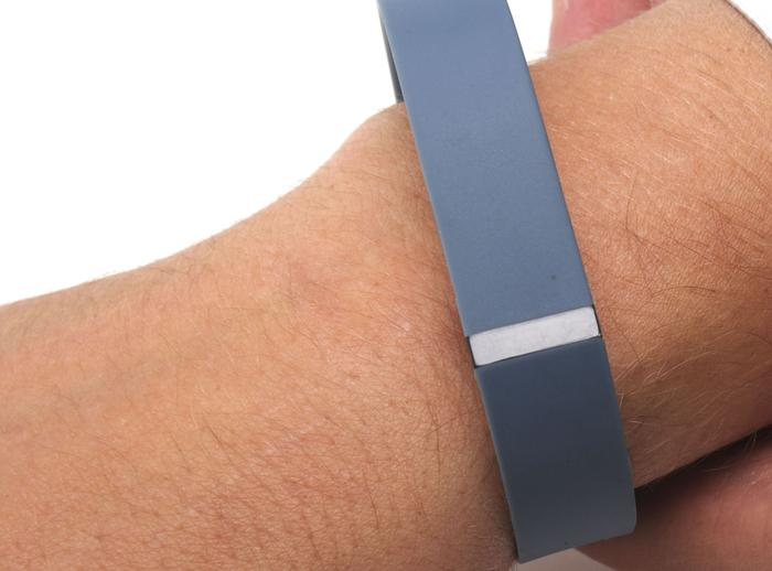 The Fitbit Flex is water resistant so you can wear it in the shower without any issues.