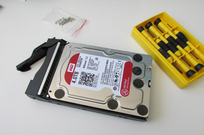 4TB WD Red drive installed in a drive caddy for testing. A screwdriver is the only tool you'll need, and screws are included.