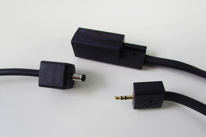 The two speaker cables plug together, then the power adapter plugs in to one end. Fitting the speaker cables together for the first time proved difficult, as the rubber connectors were hard to align.