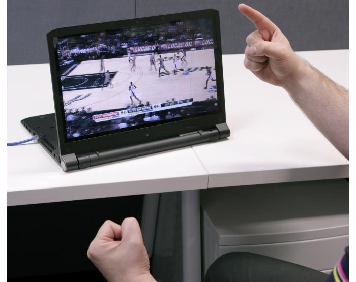 Here's the notebook in action as a display for the NBA League Pass streaming service. Apart from the excited basketball watcher, notice also the Ethernet cable sticking out, which came in handy when we didn't have Wi-Fi access.
