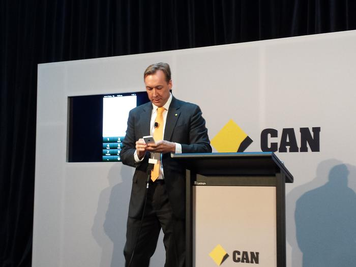 CommBank executive general manager for Cards, Payments, Analytics and Strategy, Angus Sullivan, demonstrating the new CommBank app at a Media event in Sydney.