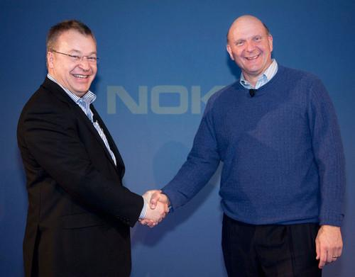 Microsoft's Steve Ballmer and Nokia's Stephen Elop shake hands