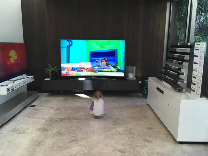 Nowadays we're more worried about kids getting squashed by gigantic TVs than worrying about eye strain if they sit too close.