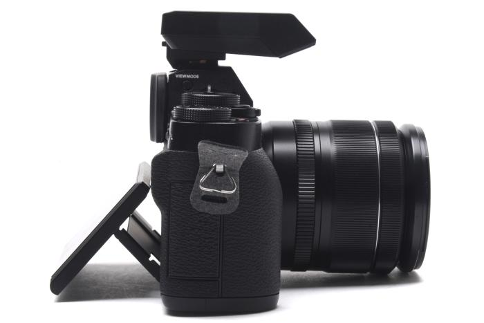 Here's a side view with the screen angled out and the EX-X8 flash mounted in the shoe.