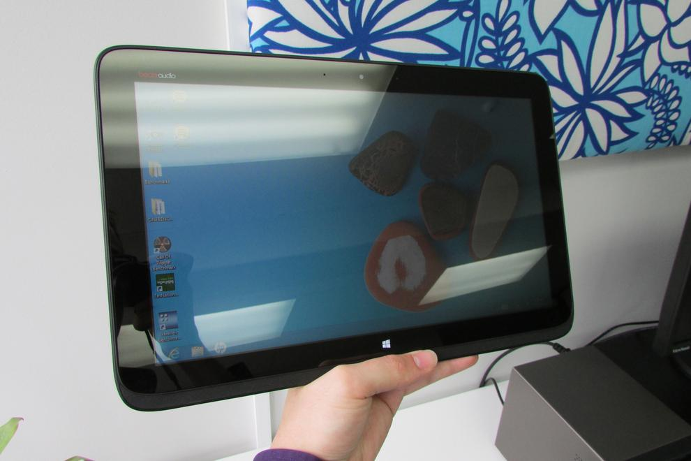 The 13.6-inch, 1366x768-pixel screen is highly reflective -- enough so to be annoying, even in moderate indoor lighting.