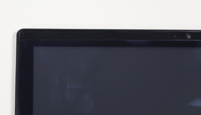 The Gorilla Glass doesn't extend to the top of the screen. The way it's attached could also leave it prone to separating from the screen if the screen is flexed -- which isn't likely to happen during the regular operation of the laptop.