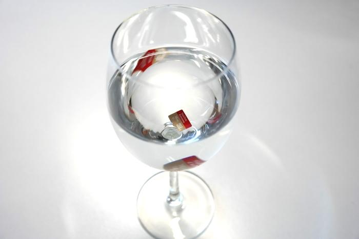 The 16GB SanDisk Extreme microSDHC card sitting in a glass of water.