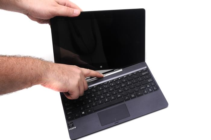 The hybrid nature of the Transformer Book T100 means you can use it as a notebook or as a tablet. To use it as a tablet, simply press the button to release the screen from the base.