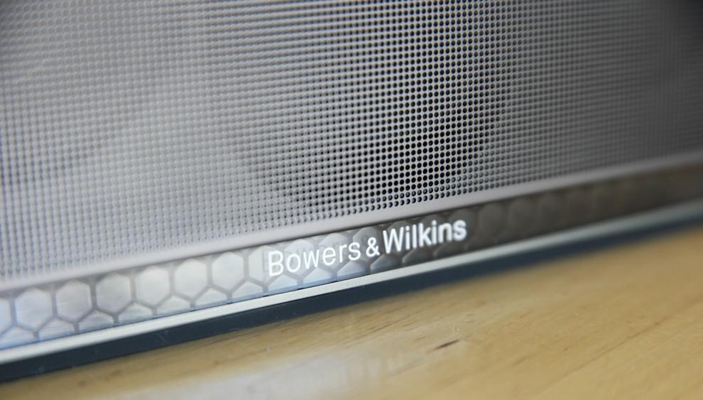 Spoiler: Long study is needed before a single, symmetrically placed feed can be spotted behind the ampersand of the 'Bowers & Wilkins' logo. Power is presumably passed from the battery to the controls through this clean link, which can only be viewed from one angle.
