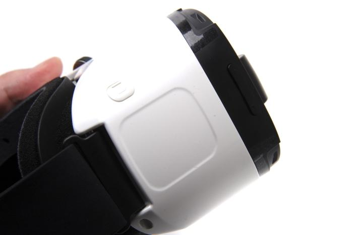 The touchpad and back button on the right side of the headset.