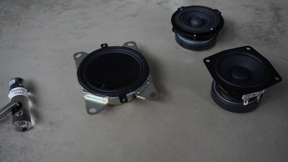 Right to left: The magnetic ferrofluid used inside a magnetic fluid speaker; Sony's magnetic fluid driver; and conventional drivers, which are larger and yet less powerful.