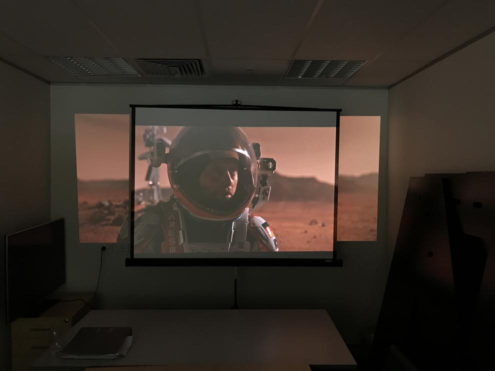 We found there was little difference in picture quality when using a projector screen or a white-washed wall, so we got rid of the screen.
