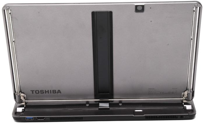 A lot of the mechanism is visible on the rear of the laptop. The rear also has the HDMI port, power port and the exhaust vents.