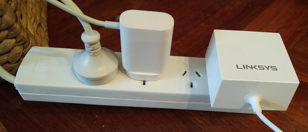 Honestly, who designs big bulky plugs like this? For reference, the Google WiFi node plug is in the middle.