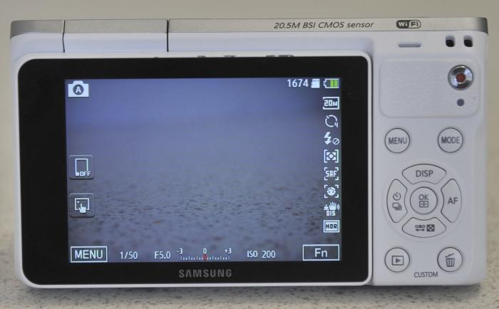 A mixture of touchscreen controls and buttons have to be used. The Fn button on the screen is what brings up the exposure settings.