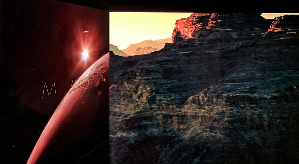 On the left our camera once again couldn't match the detail of the Sun rising over Mars but it was there. In scenes like this, not having pure-black letterbox bars can be distracting. On the right we see all the detail in the dark cliffs AND detail in the bright areas. Again, it looks better than our camera could capture.